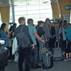 Passengers waiting to board a flight at Burlington International Airport