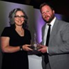 VCFA president Thomas Greene presents the Vermont Book Award to Kerrin McCadden