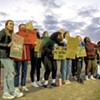 Students from Champlain Valley Union High School supporting the Winooski High School boys' soccer team