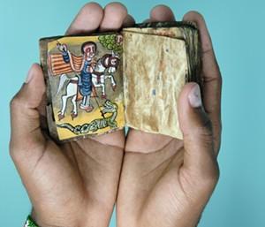 COURTESY OF DAVIS FAMILY LIBRARY - A tiny book on display