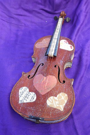 COURTESY OF MITCH AND ANNE BECK - Collaged violin by Mitch and Anne Beck