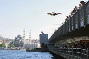 """COURTESY OF BMAC - """"Swimmer, Galata Bridge, Istanbul, Turkey"""" by Joshua Farr"""
