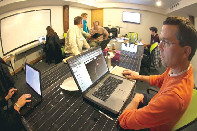 Volunteers work on map editing at Office Squared in Burlington