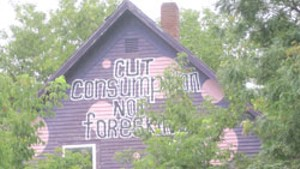 "WTF: Why does a Burlington house tell passers-by to ""cut consumption, not foreskin?"""