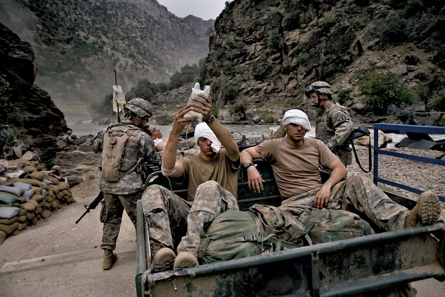 Wounded U.S. Army soldiers  await evacuation by helicopter from Kamdesh, Nuristan province. - COURTESY OF ROBERT NICKELSBERG