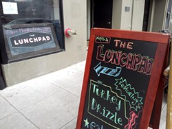 PETE KANE - A chalkboard sign draws visitors into the makeshift lunch pop-up in Hayes Valley.