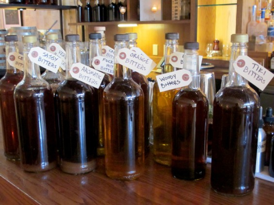 A collection of Plum Bar bitters - LOU BUSTAMANTE