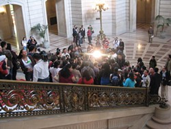 A crowd gathers around Supervisor David Campos after today's veto override