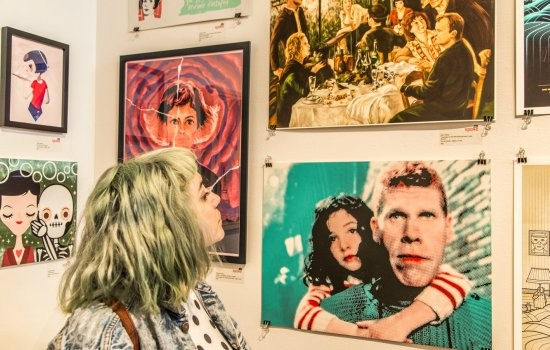 A gallery visitor checks out the art in a Jean-Pierre Jeunet and Marc Caro-themed show. - PHOTO BY ODELL HUSSEY, COURTESY OF SPOKE ART.