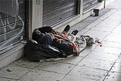 A laid-off Chronicle writer sleeping on the street in his own filth.
