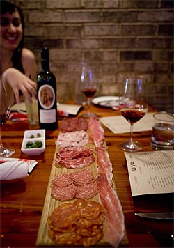 JEN SISKA - A light meal of olives, thinly sliced cured meats, and vino.