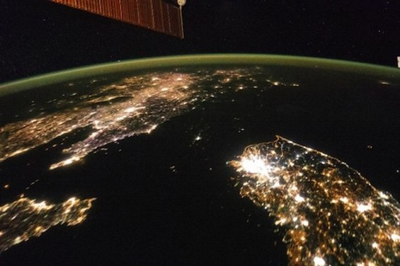 A photo released Monday of the Korean Peninsula at night, with the north shrouded in darkness. - © NASA NASA / REUTERS/REUTERS