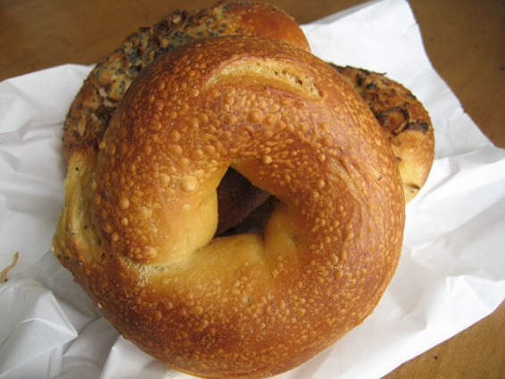 A plain Terra (formerly Roland's) bagel, backed by a bialy and an onion bagel. - JONATHAN KAUFFMAN