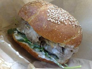A pork shoulder sandwich from Pal's Takeaway in Tony's Market. - TAMARA PALMER