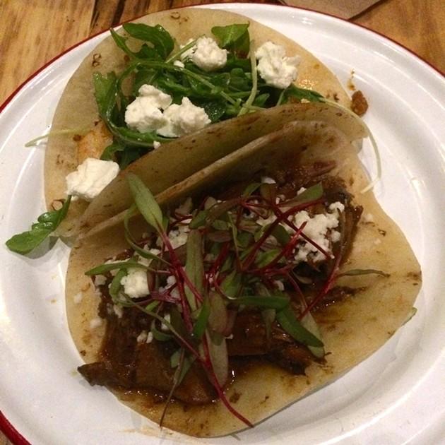 A prawn & chorizo and duck mole taco. - PETE KANE