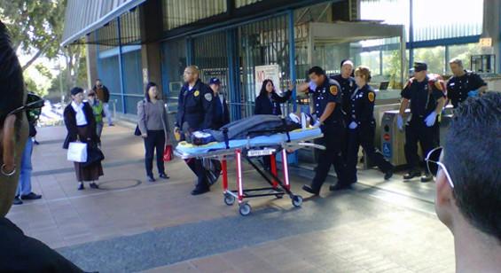 A stretcher leaves the Glen Park BART station. - LAUREN SMILEY