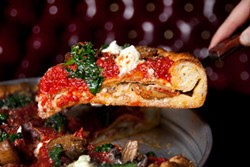 LARA HATA - A stuffed deep-dish slice topped with ricotta and spinach.