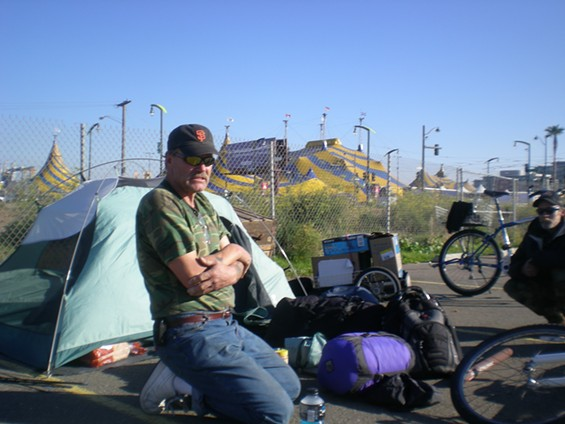 A tale of two tents: Jeff, left, with his buddy Mike. 'I can stay inside for a while, but after four or five days, I need to get outside,' says Jeff. 'It clears my head.' - JOE ESKENAZI