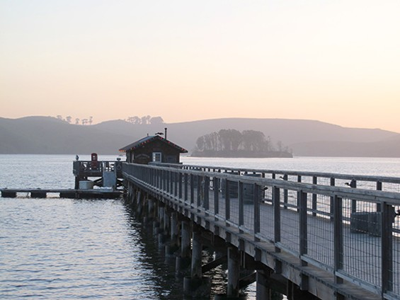 A view of the pier and fishing shack at Nick's Cove - LOU BUSTAMANTE