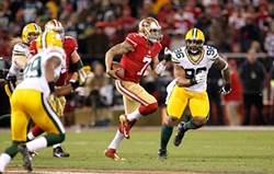 AP PHOTO/ TONY AVELAR - Against the Green Bay Packers earlier this month, Colin Kaepernick showed why he represents the changing faces of the NFL and America.