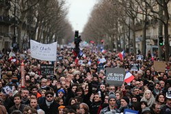 "KAY NIETFELD/PICTURE-ALLIANCE/DPA/AP IMAGES - ""All is forgiven"" reads the text above Mohammed on the forthcoming edition of Charlie Hebdo. Below, an estimated 1.5 million supporters gathered in Paris on Sunday."