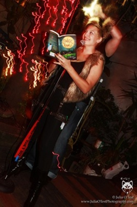 allison_reading_at_the_party_thumb_250x374.jpeg