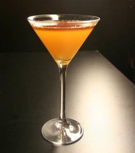 Ame's Giants Sweet Finish: White rum, orange juice, lime juice, black strap rum. - AME