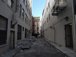 MIKE KOOZMIN - An average day in St. George Alley, San Francisco's filthiest back street.
