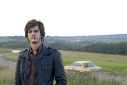 Andrew Garfield plays a junior crime reporter investigating the disappearance of local girls in 1974.