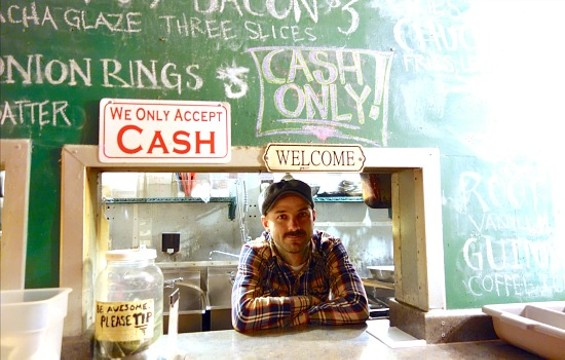 Andy Brown behind the counter at Buckshot. - FERRON SALNIKER