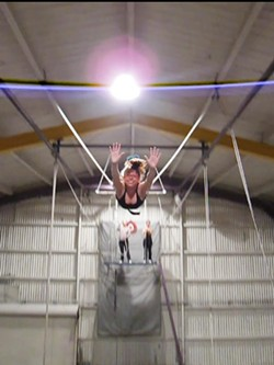 ANDREW J. NILSEN - Anna Pulley soars through the air at Trapeze Arts.