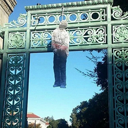 A lynching effigy dangling from Sather Gate at UC Berkeley. - LAUREN BUTLER/ONYX EXPRESS