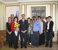 TOM  KELLY - Anti-war groups brought sunflowers to the Russian - Consulate.