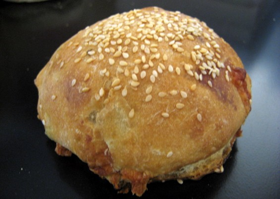 Arizmendi's provolone-olive bread, available as a braided loaf and a roll. - JONATHAN KAUFFMAN