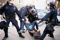 JP DOBRIN - Arresting an Occupy Oakland protester, Oct.  25, 2011.
