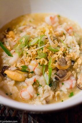 Arroz caldo with mussels, scallops, and prawns. - JUN BELEN