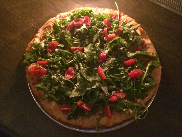 Arugula and prosciutto pizza. - PETE KANE