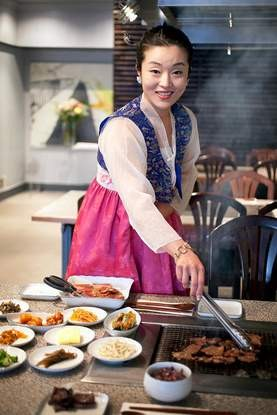 Ashley Lee, manning the barbecue table. - LARA HATA