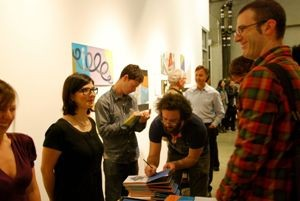 Author Brian McMullen and artist Jason Jägel sign their new book. - JACQUE KRAMER, SOUTHERN EXPOSURE