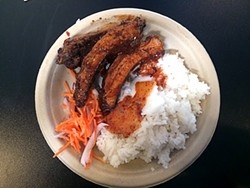 PETE KANE - Baby back ribs rice plate.