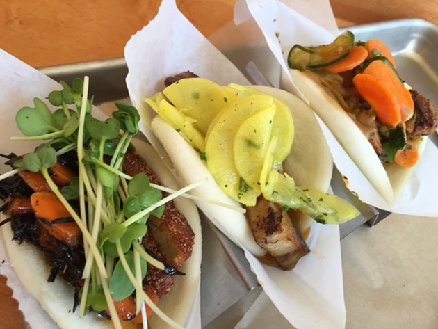 Bao: tempeh, pork belly, and spicy chicken. - PETER LAWRENCE KANE