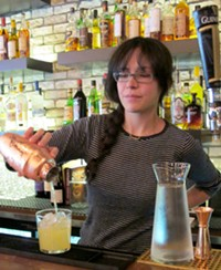 Bar manager Claire Sprouse shaking up a cocktail - LOU BUSTAMANTE