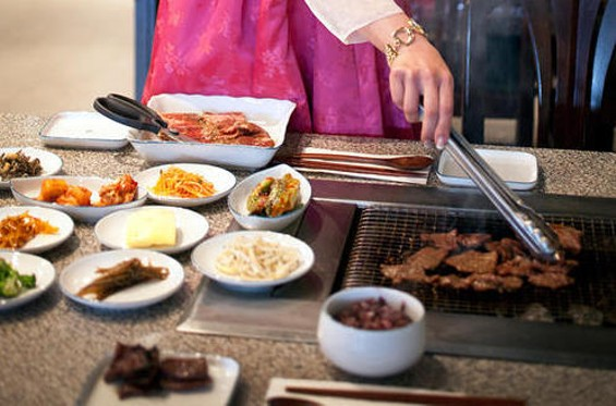 Barbecuing kalbi at Jang Soo. - LARA HATA