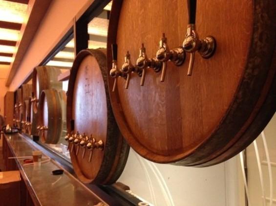 Barrelheads function as taps at City Winery's new Napa location. - CITY WINERY