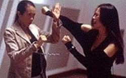 Battling Beauties: Sourpuss detective Kong - Yat Hong (Karen Mok) and hot hacker Lynn - (Shu Qi) duke it out.