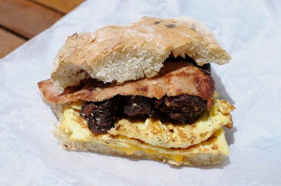 Belfast bap with egg, Irish bacon, cheddar, and black sausages ($6). - CHRIS MACARTHUR/SF WEEKLY