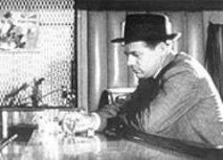 Belly up to the bar: A businessman feels the burn in the 1959 film Ulcer at work.