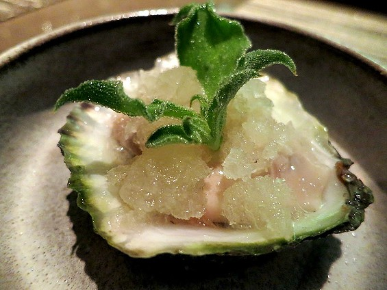 Belon oyster topped with salty seaweed ice, wekiwa tangelo, and an ice plant leaf at Manresa. - THE DAPPER DINER