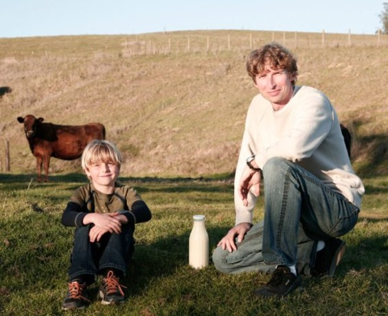 Benoît de Korsak on the pasture with his son Pierre, one of his Jersey cows and his new milk.