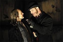 KEVIN BERNE - Bill Sykes (Gregory Derelian) confronts Fagin (Ned Eisenberg) in Berkeley Rep's Oliver Twist.